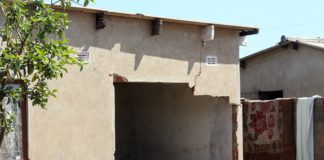 UNLICENCED POLICE OFFICER RAMS INTO HOUSE, FAILS TO PAY FOR REPAIRS