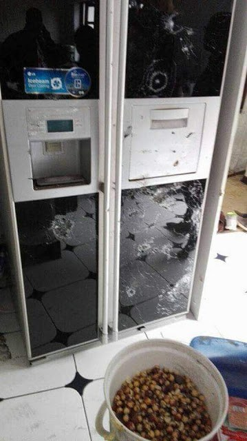 CHOMBO'S HOUSE AFTER THE FRACAS