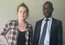AMERICAN CHARGED WITH INSULTING MUGABE