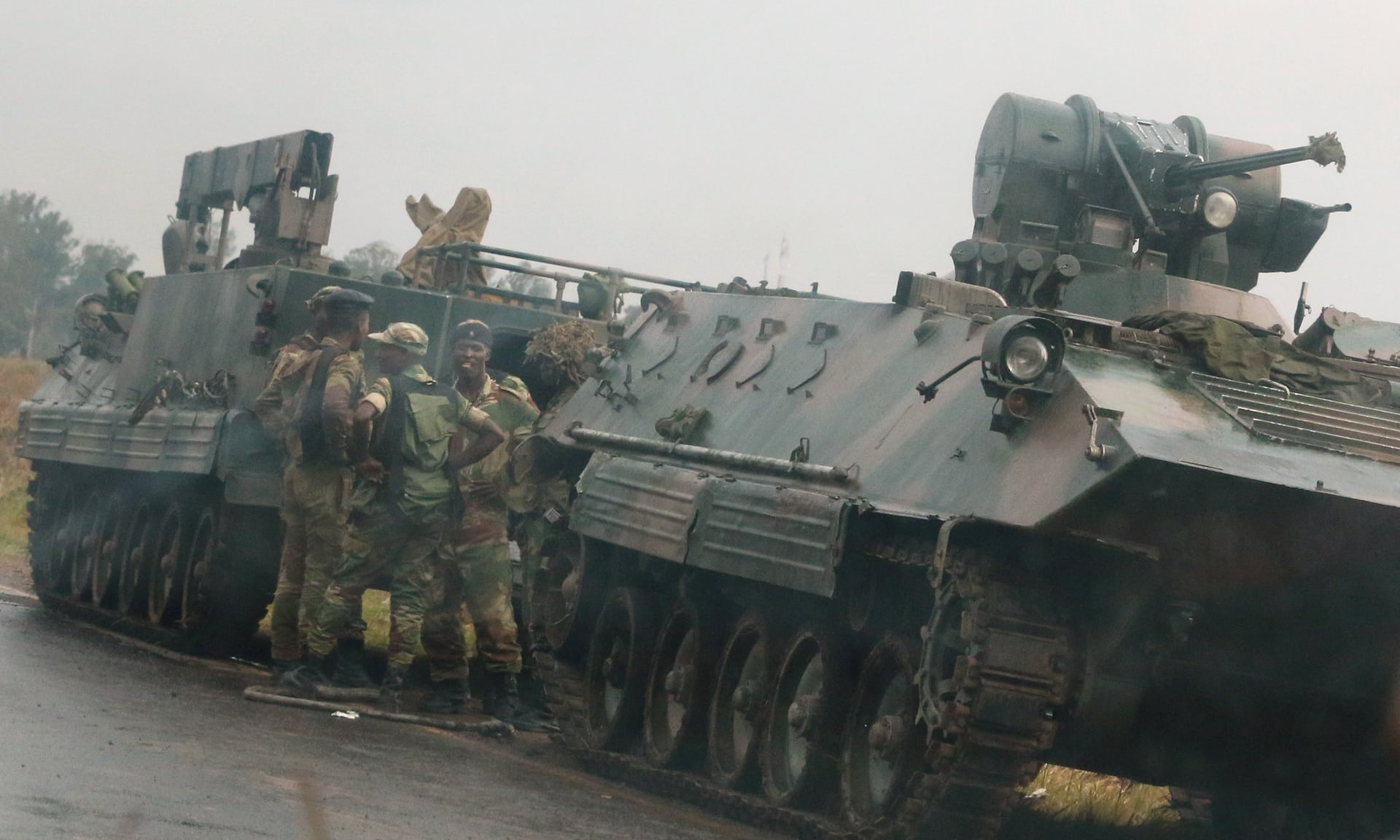 TENSION RISE IN ZIMBABWE AS MILITARY DRIVES THROUGH OUTSKIRTS OF CAPITAL