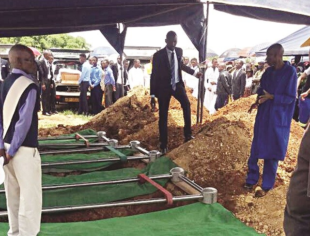 KILLER SOLDIER'S VICTIMS BURIED SIDE BY SIDE IN TENSE CEREMONY