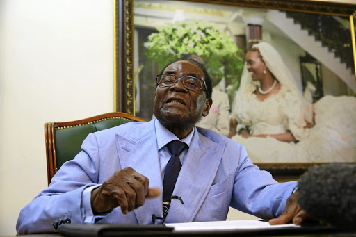MUGABE DOWNGRADES SENSE OF DRESSING