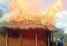 woman locks herself and 4 kids in bedroom hut and sets it on fire after brawl with husband