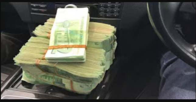 $200k discovered in a police officer's car