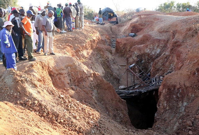 Villagers at the collapsed mine.