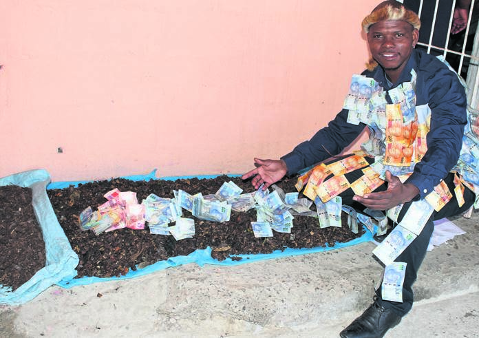 Sangoma Dresses Up In Money, Throws Cash At 'People In Need'