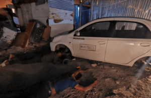 4 men caught red-handed stripping down hijacked government vehicle